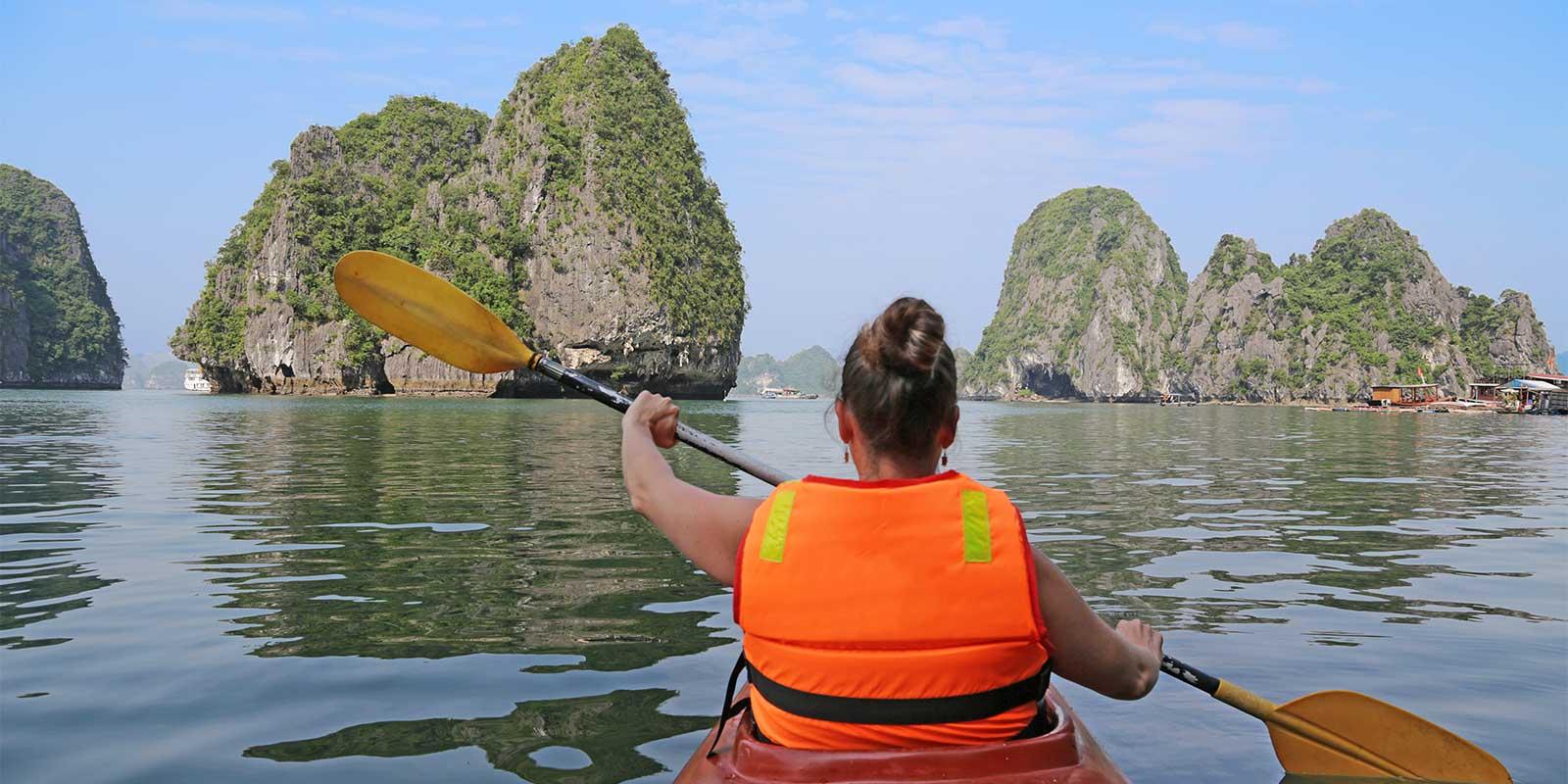 Young girl kayaking in Halong Bay Vietnam