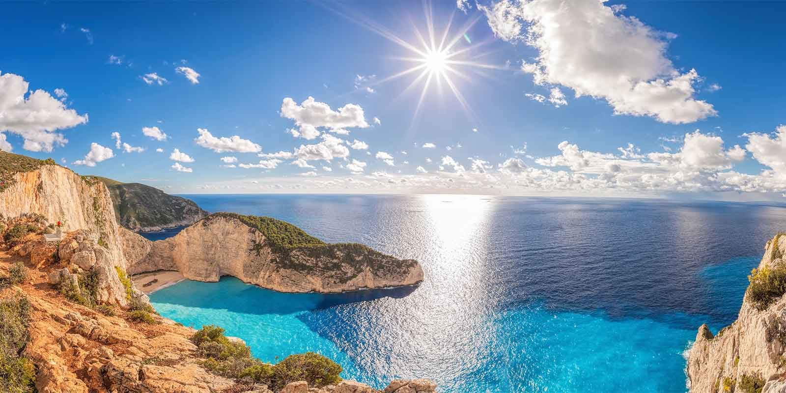 Turquoise bay and cliffs at sunset on Zakynthos island in Greece
