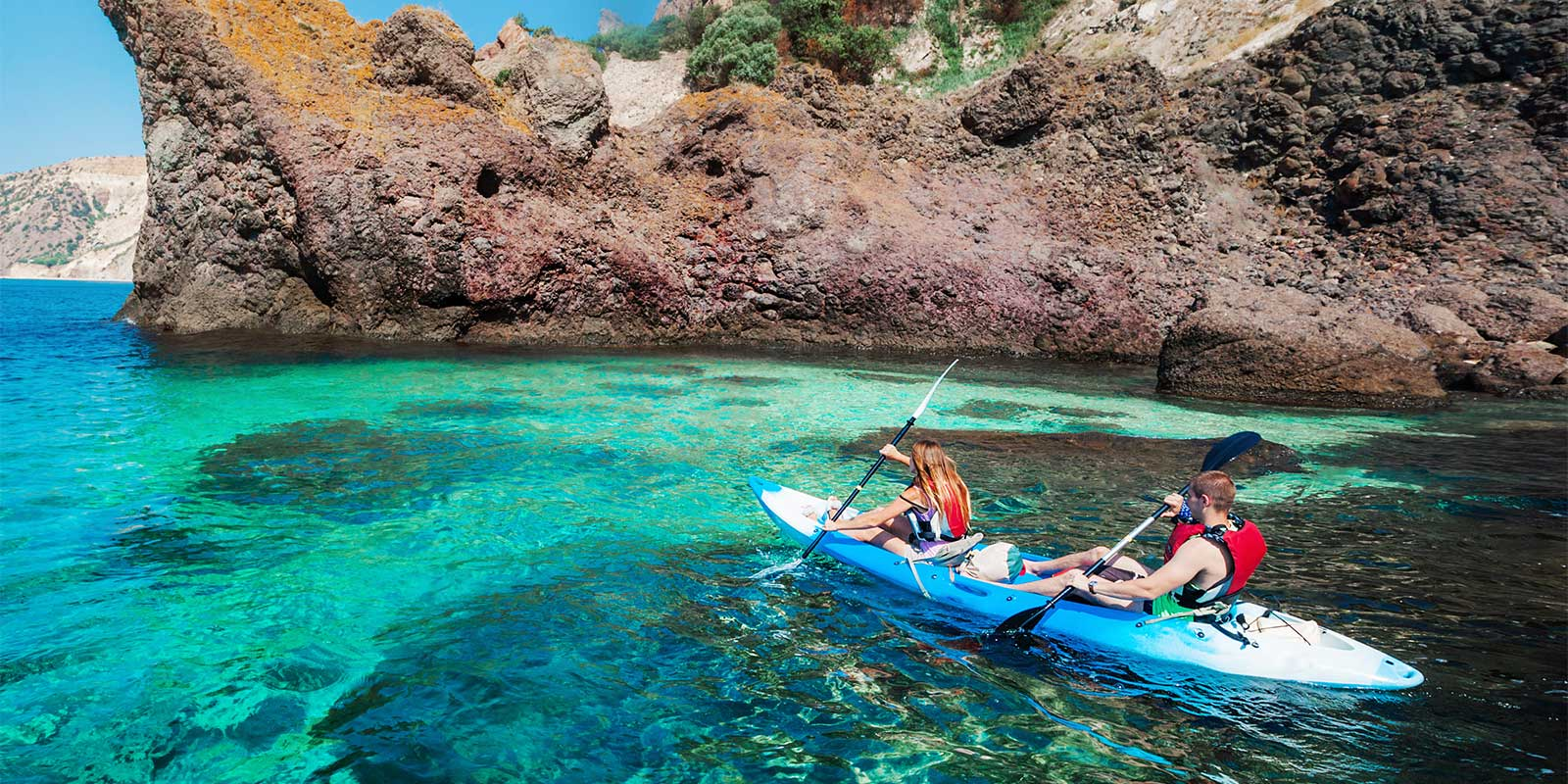 Young people kayaking around coastal waters in Turkey