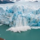 Section of Perito Moreno glacier breaking off into lake, Los Glaciares National Park in Argentina