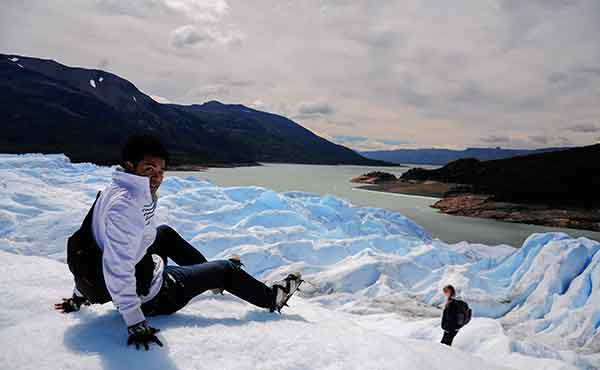 Young boy trekking on glacier in Patagonia, Argentina